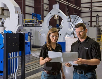 Jennifer Gaines, mechanical design engineer at Sulzer with a colleague in the factury of Sulzer La Porte, TX, USA