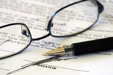 Glasses and a pen lying on a contract