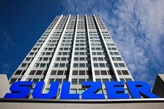 Sulzer Headquarters Building with blue Sulzer Logo on it