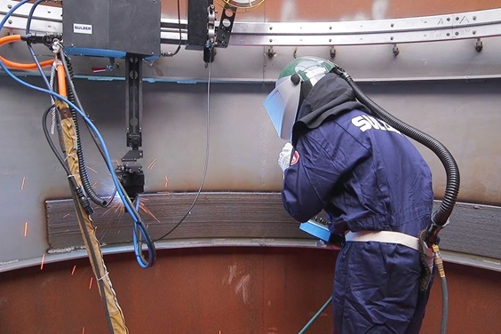 Sulzer employee doing weld overlay