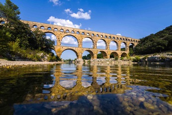 Pont du Gard aqueduct in France with water in the front