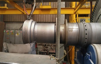 The coupling repair process began with submerged-arc welding.