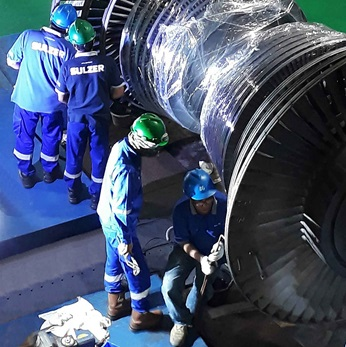 Detailed inspection of steam turbine rotor.