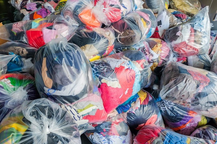 Old clothes in plastsic bags for donation or recycling