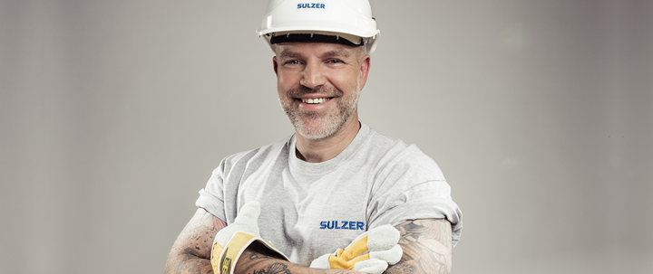 Construction worker with a helmet and tattoos on this arms