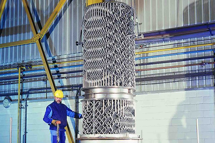 Employee installing heat exchanger - Sulzer Mixer Reactor SMR