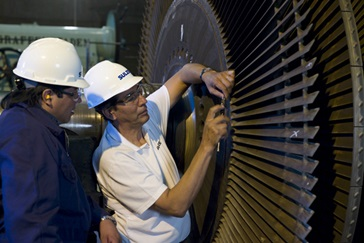 Two engineer repairing a rotor