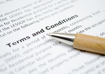 Terms and conditions document with pen