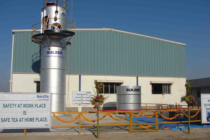 Sulzer Tower Field Service Workshop with safety banner in front