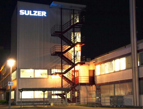 Sulzer production site and offices in Winterthur illuminated at night