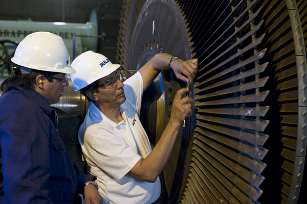 Two engineer repairing a rotator