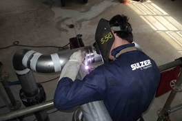 Sulzer Tower Field Service employee welding a pipe