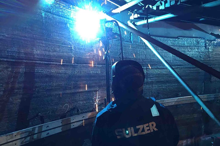 Welder in column doing weld ov